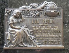 """The marker of The grave of Eva """"Evita"""" Peròn. It symbolises how important she was and still is in the lives of the Argentinean people. The inscription reads among other things """" I am an essential part of your existence"""" further adding to her status as a cultural myth"""