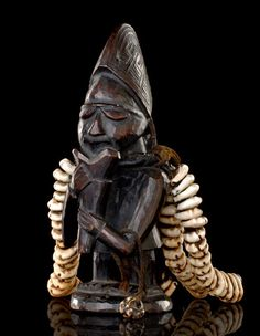 Yoruba Eshu Shrine Figure, Nigeria .In the Yoruba tradition the god 'Eshu' is a mischievous trickster figure who enjoys confusion on a cosmic scale . Many stories tell of tricks he plays that cause arguments . In one myth he lured the sun and moon into changing places, which upset the cosmic order. 'Eshu' is the god of change, chance, and uncertainty.