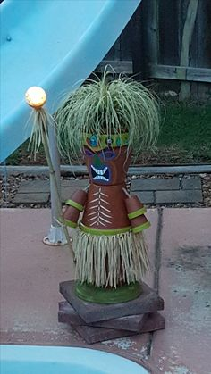 My first Tiki pot. He's so cool at night by the pool think I'll make tw… My first Tiki pot. He's so cool at night by the pool think … Flower Pot Art, Clay Flower Pots, Flower Pot Crafts, Flower Pot People, Clay Pot People, Clay Pot Projects, Clay Pot Crafts, Tiki Party, Luau Party
