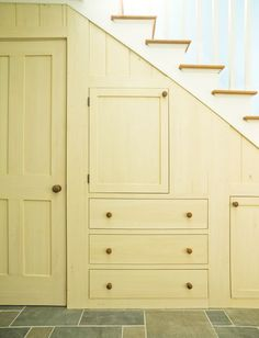 Shaker like storage under stairs. This would be perfect for the downstairs bedroom!! CS