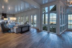 Florida waterfront home. Floor to ceiling windows. Interiors with floor to ceiling window ideas. Home floor to ceiling windows Cabin Plans, House Plans, Waterfront Homes For Sale, Luxury Interior Design, Coastal Interior, Coastal Decor, Interior Ideas, Flooring Sale, Wood Flooring