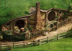 earth sheltered hobbit house - can't tell if it's CGI, but it's still a beautiful example