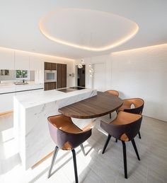 Reimann Interior & Design I private residential kitchen by Julius Reimann - calacatta statuario center element, soft architecture light design and Poltrona Frau Ginger dining chairs...