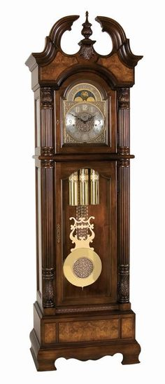 This stately floor clock features Royale Cherry finish on genuine hardwoods with Cherry and Olive Ash burl veneers. - The Olive ash burl is mounted on raised panels over the book matched Cherry on the
