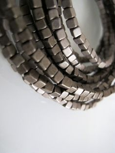 A multilayer beaded bracelet made of metal covered glass beads by K. Silver Beads, Silver Rings, Bracelet Making, Cuff Bracelets, Glass Beads, Metal, Accessories, Jewelry, Jewlery