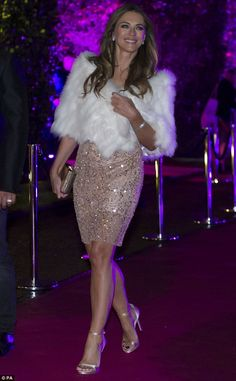 Dazzling: Elizabeth Hurley put on a dazzling sartorial display in a glittering pink mini dress as she attended the Centrepoint fundraiser at London's Kesnington Palace, on Thursday