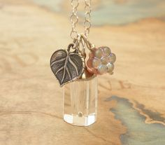 Wish Bottle Necklace  Tiny Perfume Bottle with Leaf by JewelWorks, $28.00 http://www.ecrafty.com/c-517-mini-glass-bottles.aspx?pagenum====pricedescending=60