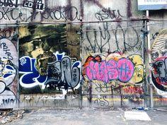 #streetart in an empty lot in #soho ! #manhattan #street #art #graffiti through a #fence … #nyc #newyork #newyorkcity #ohos #sots #seenonthestreet  #remages #overherdoverscene #seenonthestreet  #streetphotography #hipstamatic #hipsta #hipsta_junky #hipstaconnect  (at Spring Street, Soho, NYC)