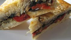 This is a delicious recipe for a focaccia sandwich with roasted eggplant and red bell peppers and sauteed portobella mushrooms.  You can substitute your favorite veggies and use any Italian flat bread you choose.