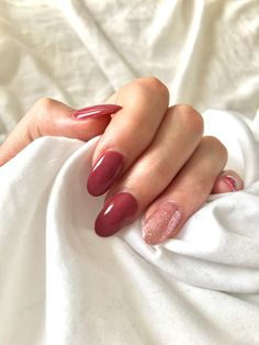 Almond shaped Dark pink nails with a sparkly ring finger love this for spring
