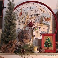 old bike wheel spray painted and filled with Christmas postcards