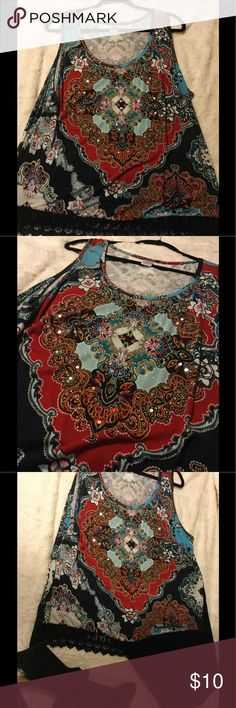 Ladies VIBRANT multi-colored sleeveless shirt Beautiful ladies sleeveless shirt  with black embroidery around the bottom and sequins scattered throughout. Looks great with black dress pants or with jeans. Add a black cardigan and wear it to work! Bila Tops Camisoles