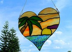Sunset Tropical Heart Stained Glass by GlassofManyColors. Would be cute in Bill's office :)
