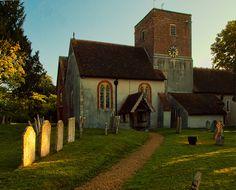 Sunrise illuminates the gravestones in St. Mary's Churchyard at Upton Grey in Hampshire by Anguskirk, via Flickr
