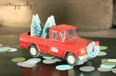 Cute Christmas Tonka truck with bottle brush trees by Vintage Junky