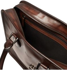 <a href='http://www.mrporter.com/mens/Designers/Berluti'>Berluti</a>'s 'Un Jour' briefcase is crafted from the label's signature hand-polished Venezia leather and, as the name suggests, is perfectly proportioned for a full day's work. Built to last, this elegant accessory is fully lined in hard-wearing twill. It's well organised too, with three internal pockets in addition to a zipped compartment.