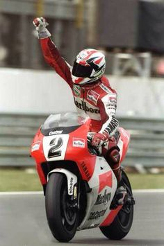 Luca Cadalora of Italy celebrates on his Yamaha after winning the class of the Brazilian Grand Prix at the Autodromo Nelson Piquet circuit in Rio de Janeiro, Brazil. Racing Team, Road Racing, Hummer, Motogp Valentino Rossi, Brazilian Grand Prix, Motorcycle Racers, Yamaha Motorcycles, Super Bikes, Street Bikes