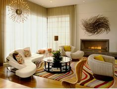 To prove that a mid-century modern chandelier is welcome in any style home, here's a contemporary french style living room. Description from neighborhoodenvy.com. I searched for this on bing.com/images