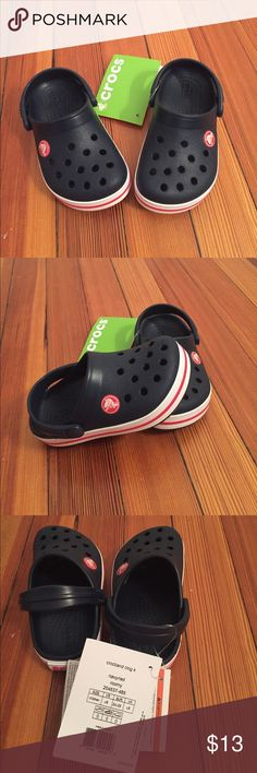 *NWT* toddler/children's classic navy Crocs BRAND NEW and never worn Crocs for your tot. These are a size 8 and my daughter is just in a size 7, so these are too big for this season...perfect for the beach or outdoor play! 💦☀️ CROCS Shoes Water Shoes