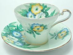 Aynsley Blue Yellow White Flowers Green Ground Corset Tea Cup and Saucer Vintage Fine Bone China Made in England