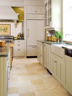 Light floors, white cabinets, darker counter tops with pattern.