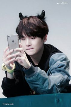What if he is pretending to take selfies but really taking pictures of army?