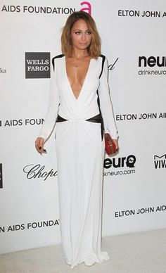 Not as plunging of a neckline, tho... love the silhouette, looks like an easy dress to wear (and eat in and dance in...)