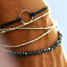 Mystic Black spinel rondelles are combined with the tiniest of tiny faceted gold vermeil beads. A delicate and sparkly bracelet. Details: Black Spinel semi-precious gemstones 24k gold vermeil tiny bea