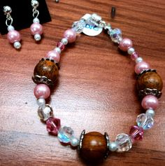 """Love Little Girl's bracelet $10.00 Free Shipping! 6"""" Magnetic clasp. Post earrings. Bubblegum pink pearls, white pearls, wood beads with silver bead toppers and Pink and Iridescent Swarovski crystals come together to create 2 pieces that every girly girl will love."""