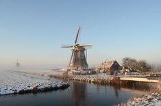 winter-windmill-landscape-holland-typical-netherlands-canal-snow-fog-35171759.jpg 800×530 pixels