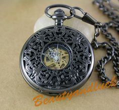 Black Archaize Pocket Watch with Watch Chain - Steampunk Victorian Vintage Style. $18.00, via Etsy.