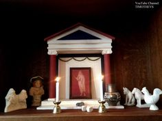 More info: https://www.youtube.com/watch?v=NDgZFJDByRo&list=PLabDxfGj6LIexV4a_OhT5kzqOE_nzgO1g My altar for the Saturnalia: On the left: sigillaria (figurines) of gladiarors and a bust of Bacchus (/Dionysos/Liber Pater). On the right: sigillaria of a dog, a horse and a rooster. In the middle: copy of fresco from Pompeii depicting Saturnus, dice, knucklebones, a wine cup and candles (all items were associated with the Saturnalia celebrations).