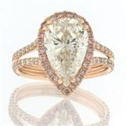 Pear Shape Diamond Engagement.. don't know how I feel about the rose gold color but in silver would be gorgeous!