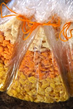 Super D's Thanksgiving feast treat for school!! Candy corn rice krispie treats. Dipped in white chocolate and put in cellophane bags.