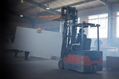Stone slab being moved with forklift at factory