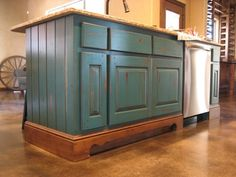 Teal Kitchen island with, crackle, distressing, and glaze to resemble country french styling.