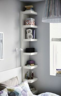This unique looking and stylish shelf is what you need for bedside stuff or decors. It goes from ceiling to floor so you can put quite a lot on this if you want.