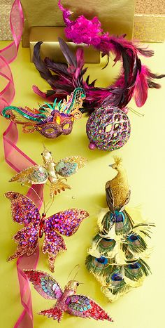 The Pier 1 Merry Masquerade Collection features Pink Harlequin and Peacock Clip Ornaments