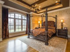 Traditional Master Bedroom with Crown molding, Exposed beam, High ceiling…