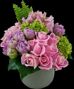 Fragrant pink hyacinth accented with lavender tulips and pink roses