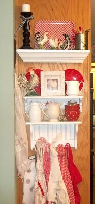 Shelves with ironstone, chickens and aprons. Red. (Ribbonwood Cottage: Farmhouse Cooking, Decorating, and baby lambs)