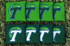 8 quality Tulane Green Wave cornhole all weather plastic pellet filled bags, made of quality duck cloth material measuring 6 inches by 6 inches, weighing between 15 to 16 ounces. Tournament level qual