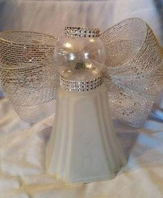 I used a light globe from a ceiling fan, glued on a clear ornament, and added ribbon for wings and used bling to accessorize. About 9 in. Christmas Crafts For Gifts, Christmas Items, Christmas Angels, Christmas Projects, Christmas Holidays, Christmas Decorations, Christmas Ornaments, Owl Decorations, Christmas Neighbor