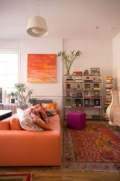 I love the colours combination, the antique rug and the art piece ... So awesome :)