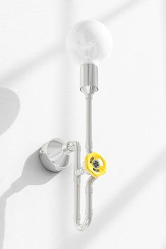 Modern dimmable sconce light. Here show in nickel metal finish, with fruit yellow dimmer knob and large milk globe bulb. A very joyful and exceptional color combination. Fun design with urban loft character.