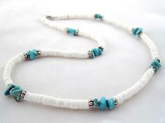 Journey of hope man's handmade necklace - $19.00 Turquoise howlite chips, white puka shell beads, and Tibet silver beads combined together for a tribal look. The necklace is strung onto tigers tail wire for strength, durability and drape. Finished off with a barrel screw clasp.