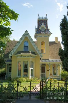 The Arnett-Fullen House, Boulder, CO - In 1877, Willamette Arnett built this excellent example of neo-gothic Victorian at its finest. In the garden, large tall cottonwood trees planted the year the house was built bloom each spring. Old rosebushes and lilacs abound. Willamette did not live out his old age contently in the comfortable gingerbread house he built. In debt, he left for the Klondike Gold Rush, dying there a pauper in Alaska in 1900.