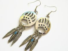 Bear Dream Catcher Earrings Paw Print by Abundantearthworks  #bearprint #bearpaw #bearclaw #bearearrings #featherearrings #feathers #feather #native #southwestern #boho #southwesternearrings #bohojewelry #dreamcatcher #dreamcatcherearrings #abundantearthworks