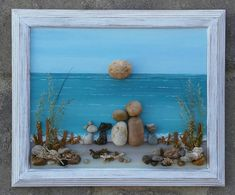FREE SHIPPING This will be made to order. Pebble Art Couple with their three sweet doggies at the beach/ocean. The background is painted in acrylics. All materials are in their natural state (pebbles, rocks, desert plants, sea shells, moss, twigs). The frame is open, painted in acrylics, and distressed, measuring 8.5x11. It is ready to hang on a wall, or stand freely. I love special requests...and dont forget to check out my shop! Thank you so much for looking. Please message with any q...