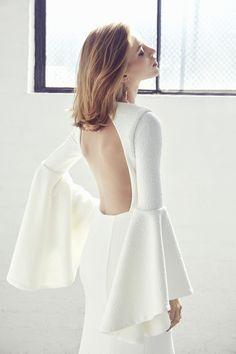 modern backless bell sleeve wedding dress by Suzanne Harward